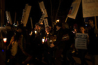 Occupy New Hampshire and Occupy the Primary protesters march toward the site of the GOP debate at St. Anselm College in Manchester, New Hampshire, on Jan. 7, 2012.