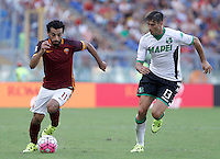 Calcio, Serie A: Roma vs Sassuolo. Roma, stadio Olimpico, 20 settembre 2015.<br /> Roma&rsquo;s Mohamed Salah, left, is chased by Sassuolo&rsquo;s Federico Peluso during the Italian Serie A football match between Roma and Sassuolo at Rome's Olympic stadium, 20 September 2015.<br /> UPDATE IMAGES PRESS/Isabella Bonotto
