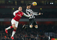 Mikel Merino of Newcastle United and Jack Wilshere of Arsenal during the Premier League match between Arsenal and Newcastle United at the Emirates Stadium, London, England on 16 December 2017. Photo by Vince  Mignott / PRiME Media Images.