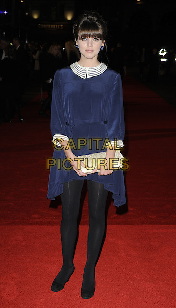 "OPHELIA LOVIBOND.The closing gala premiere of ""Nowhere Boy"" during the The Times BFI London Film Festival, Odeon Leicester Square, London, England..October 29th, 2009 .LFF full length black dress navy blue tights white collar cuffs trim clutch bag .CAP/CAN.©Can Nguyen/Capital Pictures."