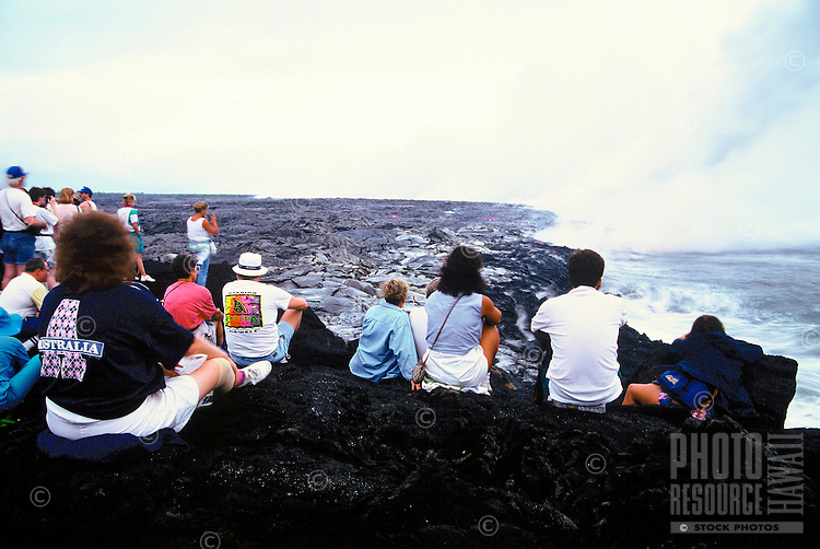 Spectators watch as new lava flows to the sea from Kilauea volcano, Hawaii volcanoes national park, Big Island