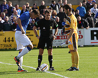 Team captains Ross McPherson of Forres and Lee McCulloch of Rangers with match referee Crawford Allan in the Forres Mechanics v Rangers William Hill Scottish Cup 2nd Round match, at Mosset Park, Forres on 29.9.12.