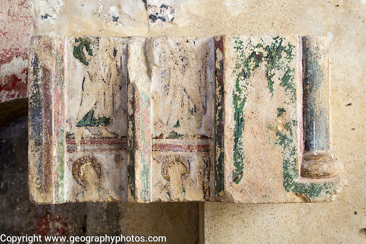 Building interior medieval church fragment of altar reredos with faded painted figures of  saints architectural feature, Inglesham, Wiltshire, England,