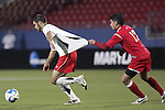 12 December 2008: Graham Zusi (left) of Maryland has jersey stretched by Nelson Becerra (17) of St. John's.  The University of Maryland Terrapins defeated the St. John's University Red Storm 1-0 during the second sudden death overtime at Pizza Hut Park in Frisco, TX in an NCAA Division I Men's College Cup semifinal game.