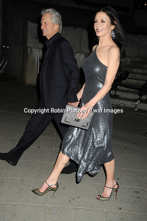 Michael Douglas and wife Catherine Zeta-Jones arrive at The Vanity Fair Tribeca Film Festival Party at The State Supreme Courthouse at 60 Centre Street on April 17, 2012 in New York City.