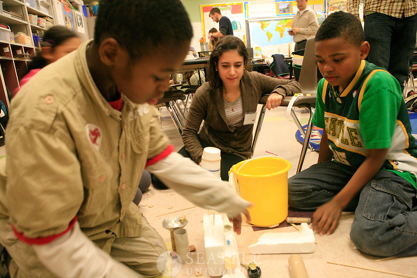 11162011 - Volunteers from Seattle University work with students at Bailey Gatzert elementary school as part of the Youth Initiative.