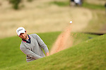 Gregory Bourdy splashes out of the sand on the 17th during the second round of the ISPS Handa Wales Open 2013 at the Celtic Manor Resort<br /> <br /> 30.08.13<br /> <br /> ©Steve Pope-Sportingwales