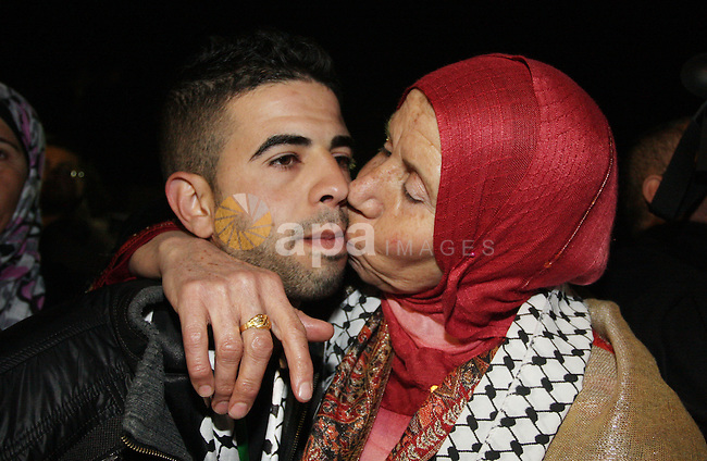 A Palestinian prisoner is welcomed after being released on December 18, 2011, at the headquarters of President Mahmud Abbas in Ramallah. Israel released 550 Palestinian prisoners to complete a swap deal which brought about the release of captive soldier Gilad Shalit. Photo by Issam Rimawi
