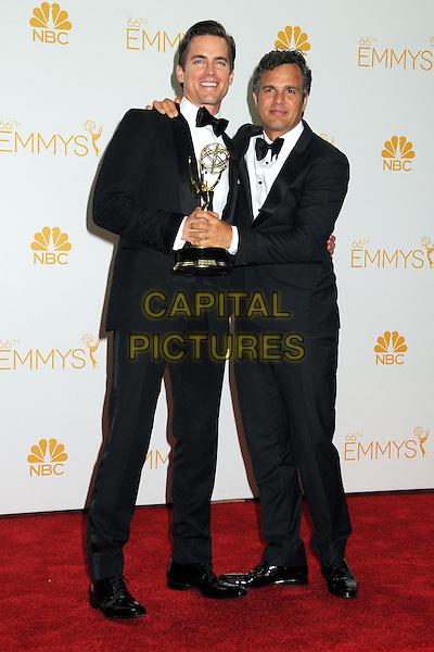 25 August 2014 - Los Angeles, California - Matt Bomer, Mark Ruffalo. 66th Annual Primetime Emmy Awards - Press Room held at Nokia Theatre LA Live. <br /> CAP/ADM/BGP<br /> &copy;BGP/ADM/Capital Pictures