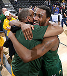 SIOUX FALLS, SD - MARCH 10: Kory Brown #22 gets a hug from a fan following the Bison's 57-56 victory over the South Dakota State Jackrabbits at the Summit League Championship Tournament game Tuesday at the Denny Sanford Premier Center in Sioux Falls, SD. (Photo by Dave EggenInertia)