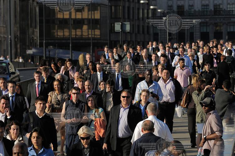Commuters crossing London Bridge.