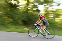 NWA Democrat-Gazette/J.T. WAMPLER A racer competes in the bicycle portion Sunday June 11, 2017 during Ladies DU Fayetteville, a duathlon for women. Around 200 women competed in the 2-mile run / 11-mile bicycle ride / 2-mile run format race at Lake Fayetteville.