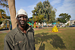 A Sudanese man hangs out at Levinsky Garden, a place that serves as a meeting place and as a pool of cheap workers, in southern Tel Aviv, Israel.