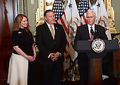 United States Vice President Mike Pence, right, makes remarks prior to administering the oath of office to US Representative Mike Pompeo (Republican of Kansas), center, as Director of the Central Intelligence Agency (CIA) in the Vice President's ceremonial Office at the White House in Washington, DC on Monday, January 23, 2017.  Pompeo was accompanied by his wife, Susan, left.<br /> Credit: Ron Sachs / Pool via CNP