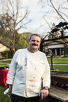 Chef Pascal Godé fires up the grill for the culmination of the Alisal BBQ Bootcamp, where participants try out their spice blends and cook their own BBQ, aided by the instructors. The Alisal Guest Ranch and Resort, Solvang, California.