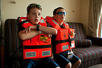 Two boys (model released) wait for the safety drill to begin during a Disney Cruise to the Bahamas in the Caribbean sea. Disney Cruise lines is one of dozens of companies sailing tourists to islands in the Caribbean Sea each week.