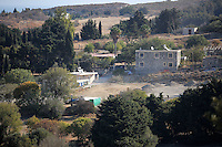 Pictured: The farmhouse where Ben Needham disappeared from (beige building on LEFT) and the plot of land used to sift through soil in Kos, Greece. Wednesday 05 October 2016<br />