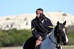 An Apache Native American Indian on a paint horse in Texas
