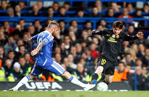 18.04.2012 Lionel Messi of Barcelona gets tackled by Chelsea's Raul Meireles ..during the Champions League Semi Final 1st  leg match between Chelsea and Barcelona from Spainn at Stamford Bridge, Stadium on April 18, 2012 in London, England.