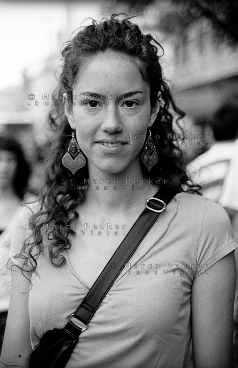 "milano, manifestazione euro mayday parade 2007. ""qual'è la tua condizione economica/lavorativa?""  ALEJANDRA, 23 anni, studentessa di scienze politiche. ""Per non chidere troppi soldi ai miei genitori faccio la hostess per mostre e fiere, do ripetizioni."" --- milan, euro mayday parade 2007 demonstration. ""How is your economic and working condition?""  ALEJANDRA, 23, student of political science. ""For not asking to much money to my parents i work as stewardess at exhibitions and fairs and i also give private lessons."""