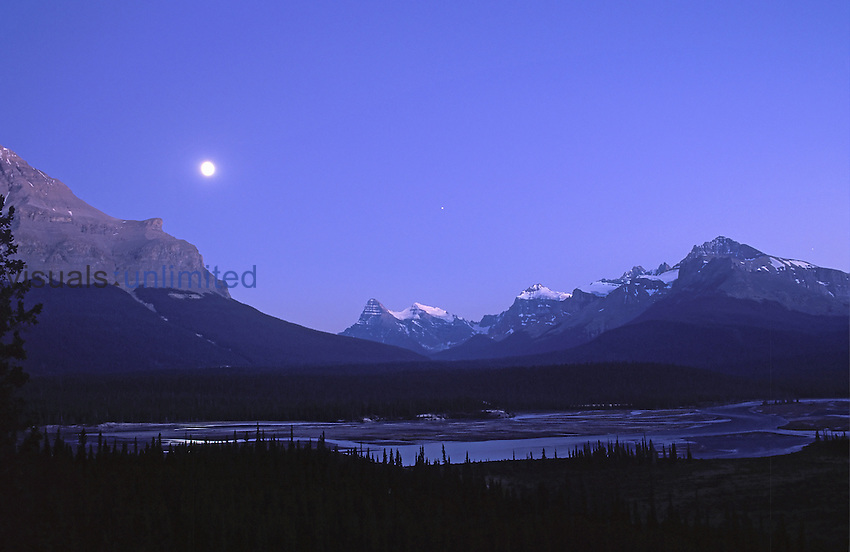 Gibbous Moon and Jupiter over Saskatchewan River, Banff, Alberta, Canada at Howse Point Overlook, with Mt. Cephren and Mistaya Valley in the distance and Mt. Murchison at the left.