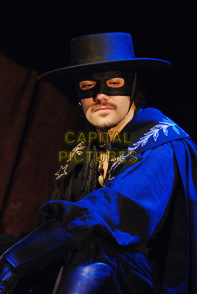 MATT RAWLE .in a scene from Zorro The Musical, based on The Mask of Zorro, Garrick Theatre, London, England, .July 9th 2007..stage photocall play costume mask black hat cape half length.CAP/WIZ.©Wizard/Capital Pictures