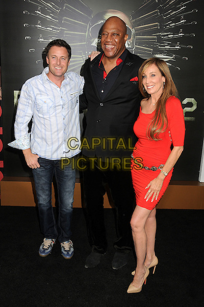 Chris Harrison, Tiny Lister, Tommy Lister & guest.'The Expendables 2' premiere held at The Grauman's Chinese Theatre, Hollywood, California, USA..15th August 2012.full length suit shirt blue jeans denim red dress black.CAP/ADM/BP.©Byron Purvis/AdMedia/Capital Pictures.