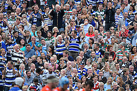 Bath supporters in the crowd celebrate. Aviva Premiership match, between Bath Rugby and Leicester Tigers on September 20, 2014 at the Recreation Ground in Bath, England. Photo by: Patrick Khachfe / Onside Images