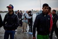Lampedusa,2011. Immigrati appena sbarcati nel porto di Lampedusa si abbracciano per essersi ritrovati e arrivati sani e salvi in Italia