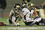 Torrance, CA 11/05/10 - Matt Hezlep (Peninsula #6) and Taylor Gimian (West # 50)  in action during the Peninsula vs West varsity football game played at West Torrance high school.