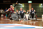 Qld's Chris Bond puts in an almighty charge on his opponent, Victorian Captain Jason Leesm in the GOld Medal match of the National Wheelchair Rugby Championships 2013 <br />