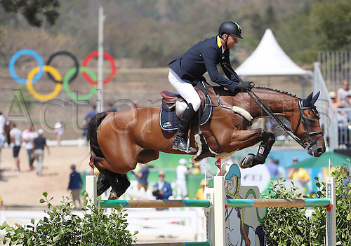 14.08.2016. Rio de Janeiro, Brazil. Ulrich Kirchhoff of Ukraine on horse Prince De La Mare clears an obstacle during the Jumping Team 1st Qualifier of the Equestrian competition at the Olympic Equestrian Centre during the Rio 2016 Olympic Games in Rio de Janeiro, Brazil, 14 August 2016.