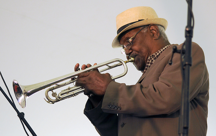 """Trumpeter, Alfredo """"Chocolate"""" Armenteros, performing with the Zon del Barrio Orchestra, at the 2014 Jazz in the Valley Festival held in Waryas Park on the Hudson River front in Poughkeepsie, NY on Sunday August 17, 2014. Photo by Jim Peppler. Copyright Jim Peppler 2014 all rights reserved."""