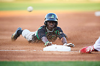 Dayton Dragons left fielder Zack Shields (7) slides into third during a game against the Peoria Chiefs on May 6, 2016 at Dozer Park in Peoria, Illinois.  Peoria defeated Dayton 5-0.  (Mike Janes/Four Seam Images)
