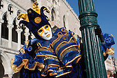 Venice, Italy, 8 February 2015. Character in a harlequin mask. People wear traditional masks and costumes to celebrate the 2015 Carnival in Venice. carnivalpix/Alamy Live News
