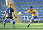 Kevin Keane of  Clare  in action against Callan Scully of  Tipperary during their Munster Minor football semi-final at Thurles. Photograph by John Kelly.