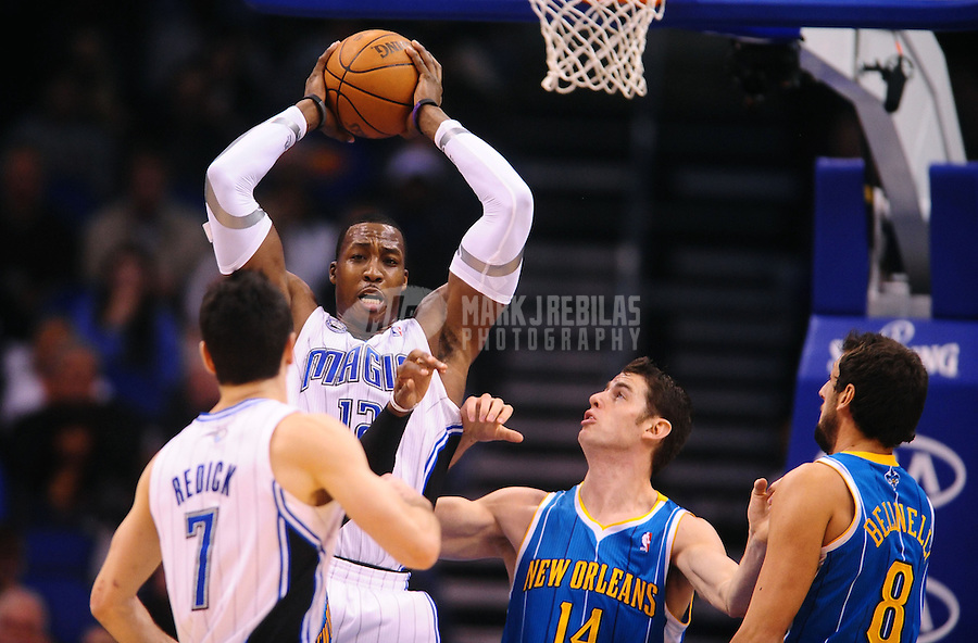 Feb. 11, 2011; Orlando, FL, USA; Orlando Magic center (12) Dwight Howard grabs a rebound in the second half against the New Orleans Hornets at the Amway Center. The Hornets defeated the Magic 99-93. Mandatory Credit: Mark J. Rebilas-
