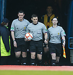 Referee Steven McLean leads the teams out with assistanta Gavin Harris and Lorraine Clark