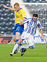 KILMARNOCK'S DANNY RACCHI GETS AWAY FROM PARS RYAN THOMSON