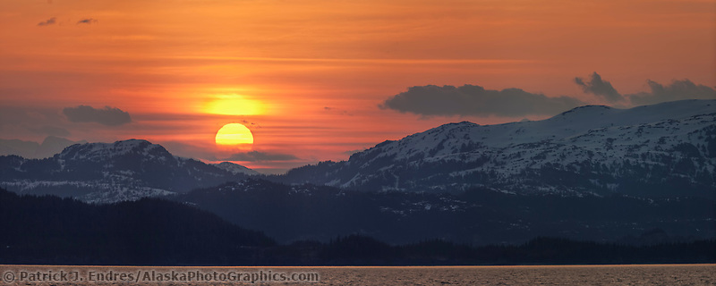 Panorama of sunset over the Chugach mountains in Western Prince William Sound, Southcentral, Alaska.