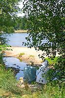 Couple taking a quiet moment to enjoy Lake Calhoun at Thomas Beach. Aquatennial Beach Bash Minneapolis Minnesota USA