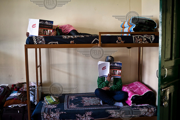 Newly arrived Tibetan refugees (concealing their identities) in the women's dormitory at the Tibetan Reception Centre.
