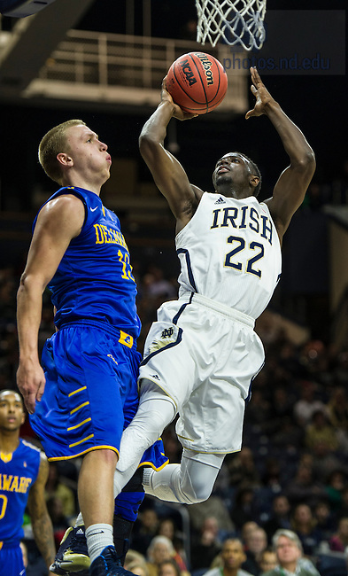 Dec. 7, 2013;  Notre Dame guard Jerian Grant goes up for a shot as Delaware guard Kyle Anderson defends in the first half.  Photo by Barbara Johnston/University of Notre Dame