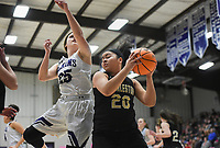 Charleston forward Alexis Grandison (20) rebounds, Friday, February 14, 2020 during a basketball game at Elkins High School in Elkins. Check out nwaonline.com/prepbball/ for today's photo gallery.<br /> (NWA Democrat-Gazette/Charlie Kaijo)