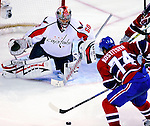 10 February 2010: Washington Capitals' goaltender Jose Theodore makes a third period save against the Montreal Canadiens at the Bell Centre in Montreal, Quebec, Canada. The Canadiens defeated the Capitals 6-5 in sudden death overtime, ending Washington's team-record winning streak at 14 games. Mandatory Credit: Ed Wolfstein Photo