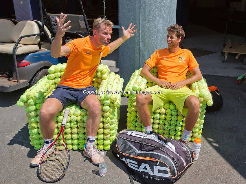 Austria, Kitzbuhel, Juli 15, 2015, Tennis, Davis Cup, Training Dutch team, after pracitse Robin Haase and captain Jan Siemerink (L) are relaxing in a ballchair<br /> Photo: Tennisimages/Henk Koster