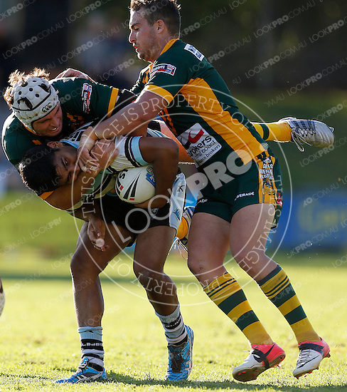 Tyrone Peachey of the Cronulla Sharks is tackled by Nathan Clarke and Brad Murray of the Wyong Roos during Round 5 of the 2013 NSW Cup at Morrie Breen Oval on April 7, 2013 in Wyong, Australia. (Photo by Paul Barkley/LookPro)