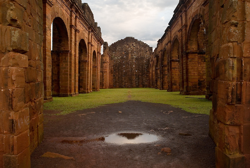 The crumbling cloisters of the church at the ruins of the São Miguel (Sao with a tilde on the a) mission in southern Brazil. Scores of Jesuit missions in the area where Paraguay, Argentina and Brazil meet were built in the 17th century and abandoned when the Jesuits were expelled in the 18th century. Ruins of some of these missions still haunt hilltops in the region. (Kevin Moloney for the New York Times)