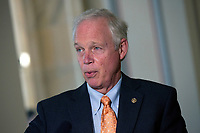 United States Senator Ron Johnson (Republican of Wisconsin) speaks to members of the media prior to a U.S. Senate Committee on Homeland Security and Governmental Affairs meeting in the Senate Russell Office Building in Washington D.C., U.S., on Wednesday, May 20, 2020, as the committee considers a motion to issue a subpoena to Blue Star Strategies.  Credit: Stefani Reynolds / CNP/AdMedia