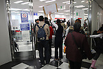 March 17, 2011, Osaka, Japan - An immigration officer guides foreign residents of Japan who are faced with long lines and at least a four hour wait for visa and re-entry permit renewal. (Photo by Daiju Kitamura/AFLO)